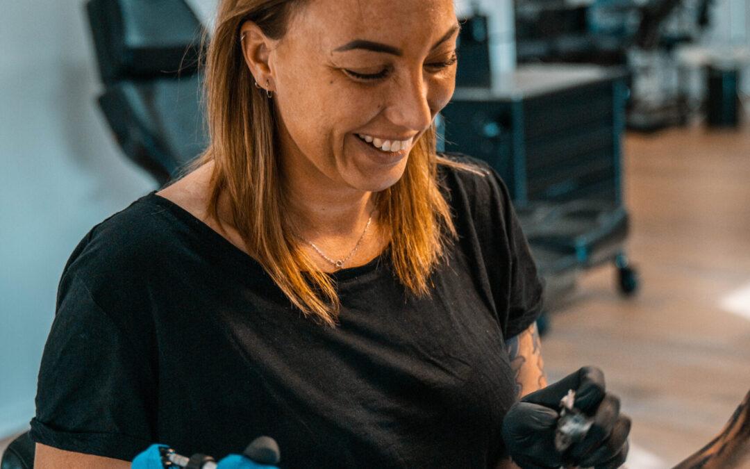 Woman tattoo artist
