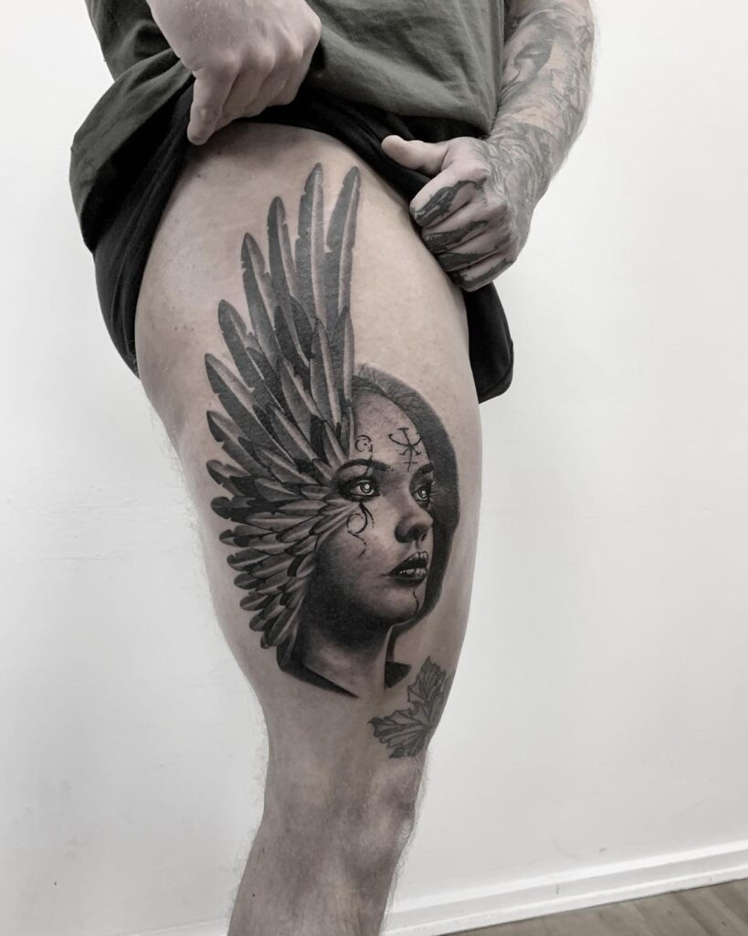 Upper thigh tattoo